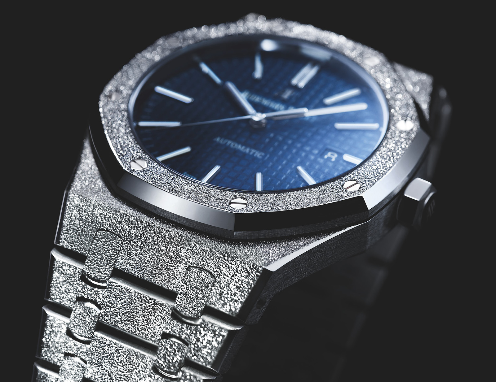 9ad8b391853 The result is a fine, Audemars Piguet Replica tactile and sparkly finish –  a decidedly modern approach that mimics the look of gem-encrustation  without the ...